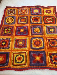 Under the Tuscan Sun afghan (some squares have patterns) by MrsJayhawk. 9 inch square.  Free pattern.