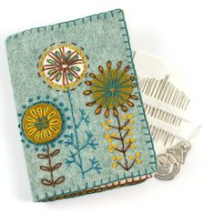 The Corinne Lapierre Needle Case Felt Embroidery Craft Kit contains everything you need to make one delicately embroidered felt Needle Case, including a pack of needles. Wool Embroidery, Embroidery Stitches, Embroidery Patterns, Tatting Patterns, Needle Book, Knitting Needle Case, Felt Applique, Sewing Accessories, Embroidery Techniques