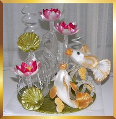 Romantic sugar art sculpture for romantic weddings. Edible. From Caramel Flowers UK. Made of isomalt and suitable for diabetics.