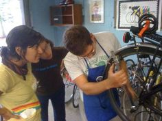 """Common Cyclebegan with a single """"mobile repair stand,"""" a portable bike workshop that travels around Ann Arbor by bicycle. Volunteers man the station to help customers fix their spokes, cranks, brakes, tires, or anything in need of repair."""