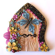 Spring Garden Fairy Door with a Blue Butterfly Pixie by Claybykim, $23.00