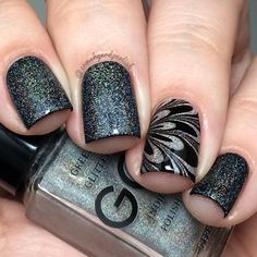 'Haute Holo' by @ggindiepolish might just be my new favorite holo topper!  Here, I have 1 coat over black.  For the accent nail, I did 3 coats of Haute Holo, then a water marble over top using black & Clearwater by @pipedreampolish (which everyone needs for negative space water marbling!!) Haute Holo will release on 6/26.  Make sure to follow @ggindiepolish for updates! #ggindiepolish #hauteholo #pipedreampolish #clearwater #watermarble #prsample