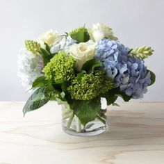 Lowry Flower Arrangement is part of Blue flower arrangements The Lowry is a lush, springy, and lowfrills blend of multiple hydrangea varieties and crisp seasonal accents (Small size shown) DELI - Hortensien Arrangements, Blue Flower Arrangements, Floral Centerpieces, Tall Centerpiece, Wedding Floral Arrangements, Wedding Flower Centerpieces, Wedding Flower Guide, White Wedding Flowers, Floral Wedding