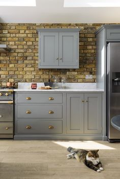 Sunny days in the dream deVOL Kitchen. Our Lead wall cupboards work wonderfully against this bare brick wall