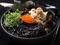 Halloween seafood ramen made with squid ink spaghetti, mussels, squid, salmon roe, and nori.