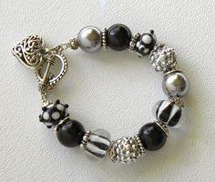 Pave Beads Handmade Beaded Bracelet Lampwork Glass Crystal Heart Charm. $35.00, via Etsy.