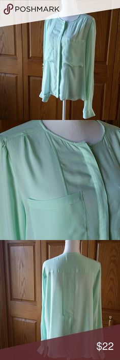 Anthropologie Maeve Light Green Dovetail Blouse Hidden button up front, button cuff sleeves, two front pockets, dovetail split open back. 100% rayon, two extra buttons on material content tag yet. Gently worn a few times. Breastline across laying flat measures 21.5 inches. Front length 24, backside 28. 19 inches on the arm inseam. Anthropologie Tops Button Down Shirts
