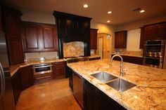 spanish kitchens with alderwood cabinets granite counters  | Gilbert Granite and Cabinet Showroom