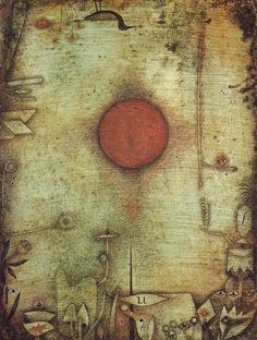 """Ad Marginem - 1930. Kunstmuseum, Basiléia. """"A solidão do homem é representada pelo sol vermelho, quase no centro do quadro, iluminando um mundo encantado do qual ele não participa. A matéria pictórica densa acentua o efeito. Dos cantos do quadro se destacam as imagens desse universo irreal, representando os sonhos, os mitos e as nostalgias do pintor. """" (""""Klee"""", Editora Globo)"""