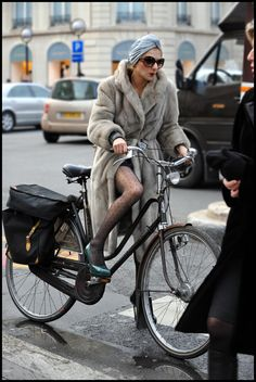 paris bicycle chic - there were lots of glamorous cyclists in Paris, none quite a glam as this one though!