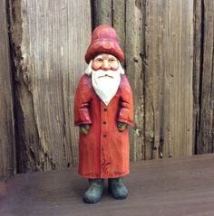 This hand carved Santa stands 8.5 inches tall. He is painted in light washes of acrylic which allows the warmth of the wood to glow through.