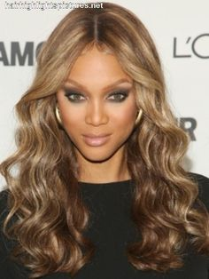 Tyra banks with dark brown hair with auburn highlights