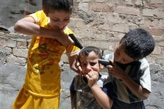 Baghdad 2007.  Children stage a mock execution