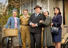 Early days: Hyacinth, her father and sisters from left, Rose, Daisy and Violet...