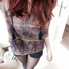 Boho top and black shorts.