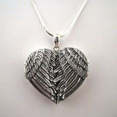 This angel wing heart locket is a larger version of our popular angel wing locket. It is made of .925 sterling silver and stamped 925. The angel wings open up to unfold a special place in the heart to put a photo or trinket of a friend or loved one. Many people use it to place ashes of a loved one inside or even a lock of hair.