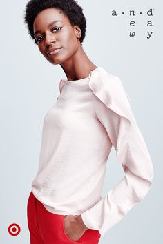 Look perfectly put together with this blush pink, ruffle-sleeved shirt from A New Day.