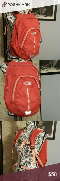 Coral North Face Backpack school hiking Coral North Face Backpack. I looked for any stains and saw a tiny spot on the front that I circled in the last picture on the right. I saw a tear on the edge of the inside of the front pocket  (I circled in the last picture, on the left side, with an arrow pointing showing that it is on the inside of the front pocket -not noticeable until you pull it back and look for it) and the middle  picture, of the last picture, is of the same tear just closer to…