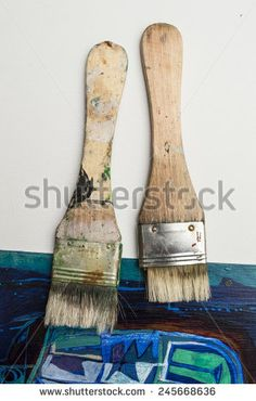 Used artist brushes on piece of artwork - stock photo