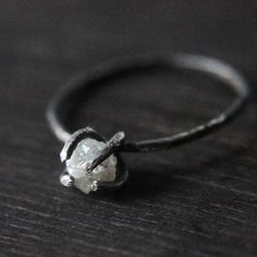 This is exactly what I want for an engagement ring! (hint, hint :) So simple and unique. http://www.urbanaviary.co/product/rough-diamond-ring-bright-or-oxidized-silver