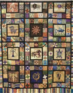 "Norma says, [This] quilt consists of twelve individual 20"" blocks with southwest designs. The 10 "" center applique design is surrounded by sixten 4 "" and appliqued blocks. We recognize this as an Elizabeth Anne pattern, a designer who specializes in Americana quilt patterns and southwestern designs."