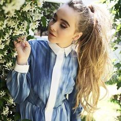 Sabrina Carpenter in a blue dress and with a ponytail.