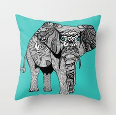 This striking throw pillow has my original illustration of a Namibia elephant with its intricate tribal-inspired pattern varying on each body part. It has some turquoise accents on the elephant's eyes, face and tail for a truly modern and edgy piece. Wouldn't this be ideal for a college student to liven up a boring dorm room? Or to add a touch of color and art in any adult or kids room.  The pillows come in your choice of either woven poplin or woven linen and in three different sizes. The…