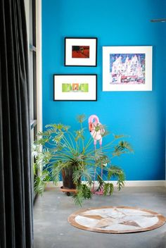 They didn't mention the exact name of this blue in Lori and Jeromy's Stylish Family Home, but Sherwin Williams Impromptu looks close.  AT 20 Bold & Beautiful Blue Wall Paint Colors