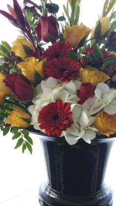Yellow, Red, White with large black urn.