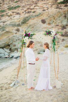 wedding ceremony - photo by Anna Roussos Photography http://ruffledblog.com/the-aegean-sea-sparkles-in-this-greek-wedding-editorial