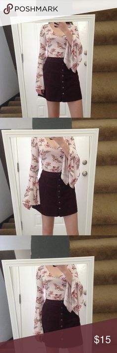 Floral Bell Sleeve Crop Top Light pink floral bell sleeve crop top with a flattering v-neck cut.  Worn once, and in perfect condition.  Hits right above the belly button. Forever 21: Size S Forever 21 Tops Crop Tops