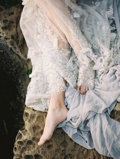 A calm and serene bridal shoot on the coast of Galiano Island, British Columbia at the Forage & Fern workshop with images by Brumley & Wells. A stunning bridal bouquet by Ponderosa & Thyme working beautifully alongside a pale grey Leanne Marshall creation