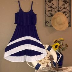 Nautical Navy & White Sundress Navy & White Nautical Sundress. Front has scooping hem. Spaghetti straps are adjustable. Top is draped over bodice. Charming Charlie Dresses High Low