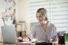 middle aged woman using a laptop and a tablet. she is a self employed and she like what she does it,she's absorbed by her work. she is at foreground Middle Aged Women, Photo Editing, Royalty Free Stock Photos, Branding, Laptop, Woman, Fashion, Editing Photos, Moda