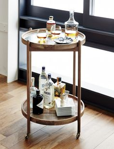 Would love this as a side table in our living room. Would have to keep it kid friendly for now but someday...Bix Bar Cart | Crate and Barrel