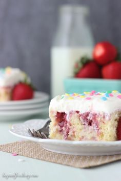This Strawberry Cheesecake Poke cake is similar to a tres leches cake. The vanilla cake is filled with sweetened condensed milk and it's topped with a fresh strawberry sauce and cream cheese whipped cream
