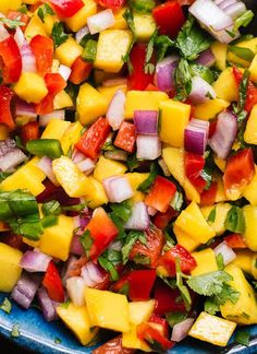 This colorful mango salsa recipe is so easy to make! It's sweet, spicy and absolutely delicious. Fresh mango salsa is great with chips, on tacos and more! Mexican Food Recipes, Vegetarian Recipes, Cooking Recipes, Healthy Recipes, Healthy Grilled Chicken Recipes, Shrimp Taco Recipes, Grilled Salmon Recipes, Juice Recipes, Detox Recipes