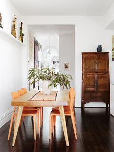 This fresh dining room couldn't be better for entertaining! From the quirky pops of tangerine orange to the old-world wood accents, we love everything about this renovated space.