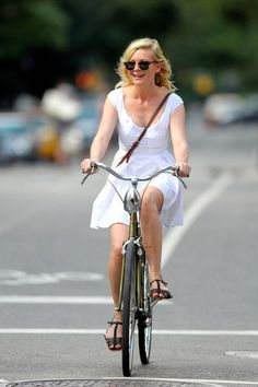 Celebrities who maintain their style while biking. Click here for more inspiration.