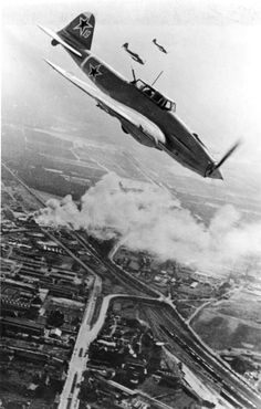 "World War II, in Russia – the Great Patriotic War (22 June 1941 – 9 May 1945). Russian ground-attack aircraft ""Ilyushin II-2"" in the sky over Berlin, Germany. 1945."
