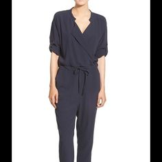 """NWT Madewell cute Navy jumpsuit M $167 With its flattering wrap neckline, rolled sleeves and tie waist, this easy-on jumpsuit pretty much styles itself. In drapey crepe, this one-piece can go from day to night with a quick shoe swap.   Easy, relaxed fit. Front rise: 11"""". Inseam: 24 1/2"""". Leg opening for size XS: 12"""". Viscose. Dry clean. Import. Madewell Pants Jumpsuits & Rompers"""