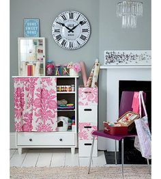 Love how the shelves are covered with pretty fabric