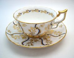 vintage English tea cup and saucer set antique por ShoponSherman