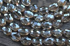 Sam's Bead Shop: Chinese Crystal Faceted Ovals, Sparkling Grey - 9x12mm - 17-pc Strand #beads #glass #crystals #artisan #beading #jewelrymaking #diyjewelry #diyjewelrymaking #jewelrydesign #handmade #diy #accessories #samsbeadshop