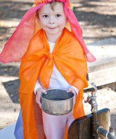 My daughters love Sarah's Silks because they are fun and versatile for play. They have been oceans, parachutes, swaddling cloths for Big Bird, capes, hats, ...