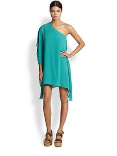 A romantic caftaninspired dress is enhanced with alluring oneshoulder styling and draped sides for a striking silhouette.Asymmetrical necklineSingle cascading draped batwing sleeveDraped sidesPullon styleAbout 33 from shoulder to hemPolyester georgetteDry cleanImported #Fashion  #SaksFifthAvenue