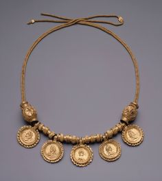 Roman, Severan                                Necklace with imitation coin pendants, early 3rd century A.D.                Gold