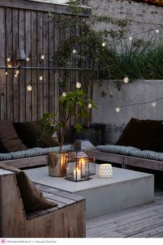 Cafe lights create ambiance overhead and the lanterns dress up this streamlined rustic look.