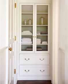 "4.  Built-in cabinet look, with glass uppers.  I love the look, but doubt you would do this. as you prefer to hide your insides.  But better sense of trim style.  Look at ""similar pins"" below this one, too, for more built-in cabinet looks"