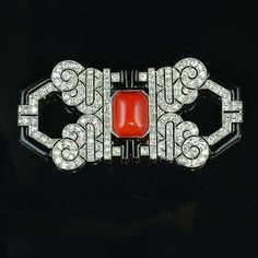An art deco coral, enamel and diamond brooch,